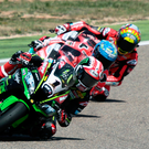 Tight corner: Jonathan Rea, pursued by Marco Melandri and Chaz Davis at Aragon yesterday
