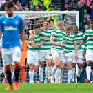 Hoop dreams: Tom Rogic celebrates with Celtic team-mates after opening the scoring in the emphatic 4-0 victory over Rangers