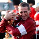 Winning jockey Davy Russell celebrates his Randox Health Grand National success on Tiger Roll.