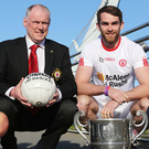 All change: Ulster GAA secretary Brian McAvoy and Tyrone's Ronan McNamee at an Ulster Championship launch