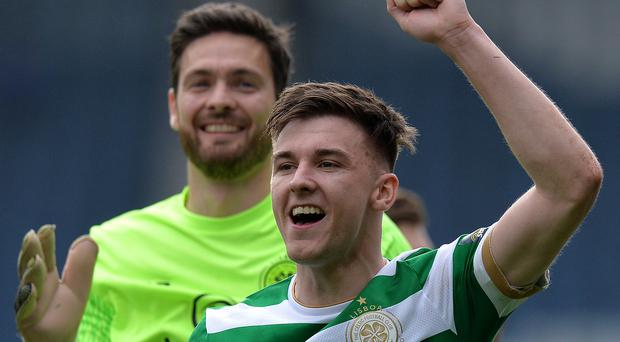 Final say: Kieran Tierney and Craig Gordon celebrate Celtic's success over Rangers at Hampden