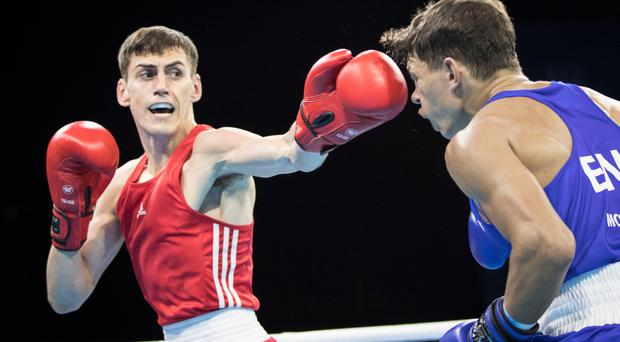 Northern Ireland's Aidan Walsh (red) in action against England's Pat McCormack (blue) during the Men's Welterweight (69kg) final at the Commonwealth Games