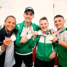 All smiles: Boxers Carly McNaul, Aidan Walsh and Michaela Walsh show off their silver medals, while gymnast Rhys McClenaghan displays his gold