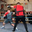 Fighting fit: Carl Frampton works out with Jamie Moore who has hailed his character