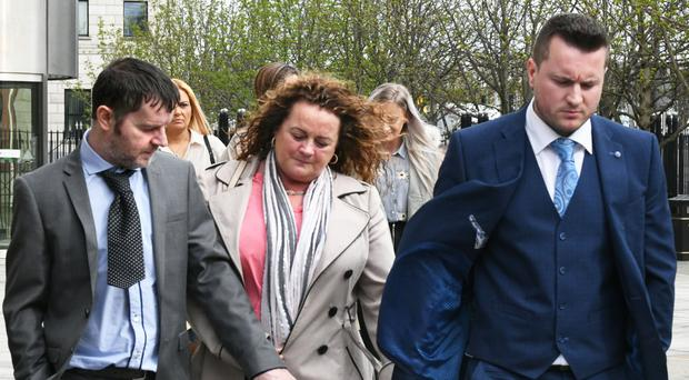Murder victim Mark Lamont's family leave Belfast Crown Court on Wednesday. Photo by Alan Lewis.
