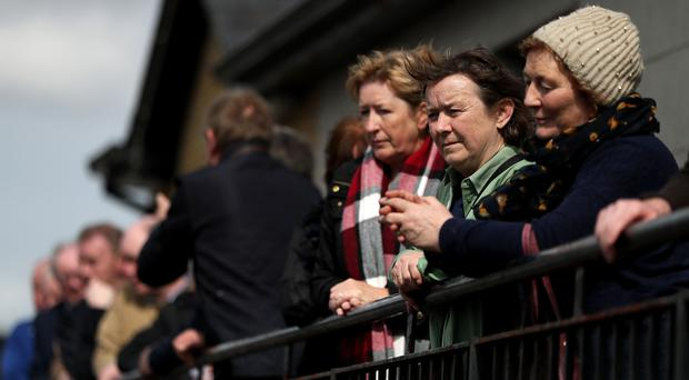 People queue to pay their respects to singer Big Tom McBride at Oram Community Centre (Brian Lawless/PA)