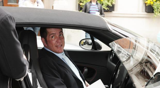 Dale Winton arrives at Claridge's Hotel for the wedding of friend David Walliams in 2010 (Yui Mok/PA)