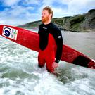 Al Mennie prepares to hit the surf on the north coast
