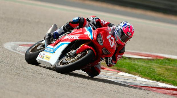 Racing stripes: Lee Johnston in action on the Honda Racing Fireblade ahead of his NW200 bid