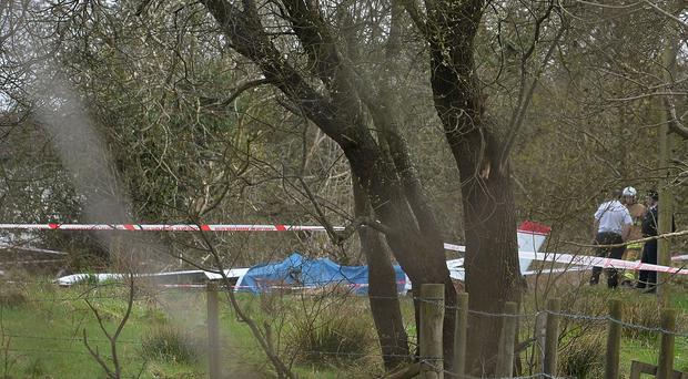 Plane crashes near Belfast Airport with emergency services at the scene