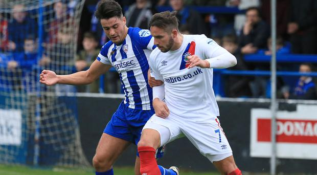 Key time: Andrew Waterworth of Linfield battles with Coleraine's Aaron Traynor