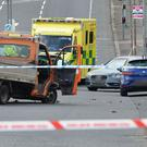 Police at the scene of the crash on the Ballysillan Road in north Belfast yesterday