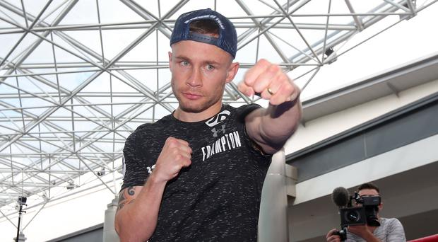 Treat for the fans: Carl Frampton in action at the public workout in Belfast's Victoria Square yesterday
