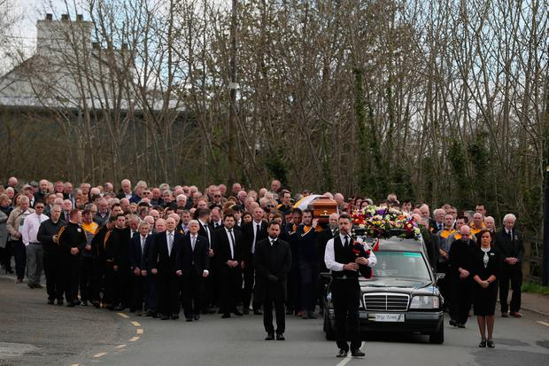 The funeral cortege makes it way to Saint Patrick's Church in Oram, County Monaghan, for the funeral of country music star Big Tom McBride (Brian Lawless/PA Wire)