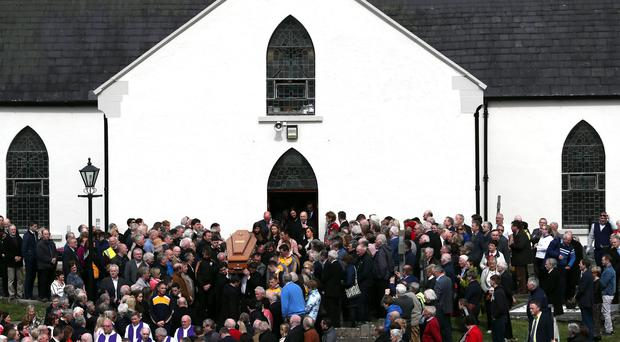 The coffin of Big Tom McBride is taken from Saint Patrick's Church in Oram, County Monaghan (Brian Lawless/PA)