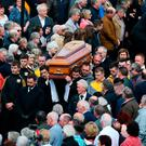 The coffin of Big Tom McBride is taken from Saint Patrick's Church in Oram, Co Monaghan, during the funeral for the country music star