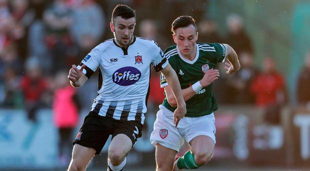 Eyes ahead: Dundalk's Michael Duffy aims to beat Derry ace Aaron McEneff to the ball at Oriel Park