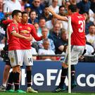 Manchester United's Spanish midfielder Ander Herrera (L) celebrates with Jesse Lingard (C) Nemanja Matic after scoring the winner in the FA Cup semi-final