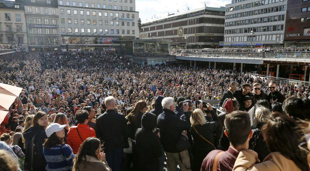 Fans of DJ Avicii gather for a minute's silence in Stockholm on Saturday (Fredrik Persson/AP)