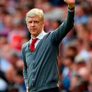 Sad day: Arsene Wenger waves to the Emirates crowd