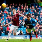 Heading home: Rangers' Daniel Candeias scoring his side's second goal