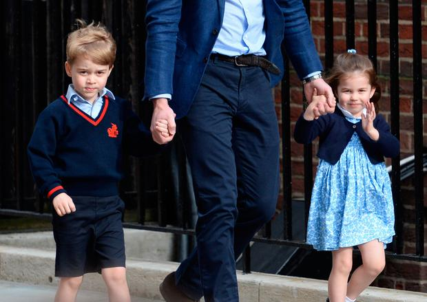 The Duke of Cambridge with Prince George and Princess Charlotte arriving at the Lindo Wing at St Mary's Hospital in Paddington, London where the Duke's third child was born on Monday. Photo credit: Kirsty O'Connor/PA Wire