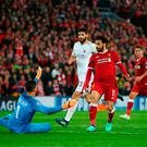 Goal spree: Mo Salah bags his second goal with a classy finish