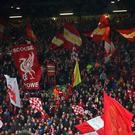 Liverpool supporters wave flags during the Champions League semi-final
