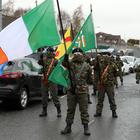 Eight men were charged in Londonderry for taking part in an illegal parade in the Creggan area on April 2 (Niall Carson/PA)