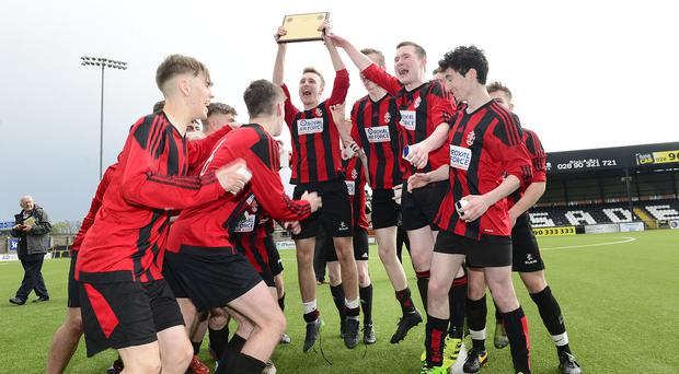 Top class: Regent House celebrate their Northern Ireland Under-18 Plate success over Methodist College at Seaview