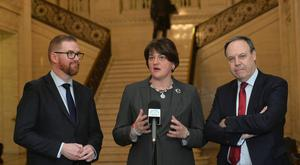 DUP Leader Arlene Foster with Simon Hamilton and Nigel Dodds speak to the media in the Great Hall, Stormont, following a meeting with Secretary of State Karen Bradley. Pic Colm Lenaghan/Pacemaker