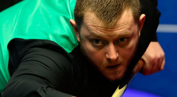 On track: Mark Allen pots his way to a 5-3 lead yesterday