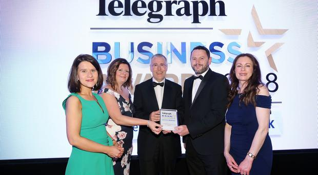 Gary Parkinson and Susan Hill from Novosco collected the Outstanding Business of the Year from Richard Donnan, Ulster Bank Head of Northern Ireland, Margaret Canning, Belfast Telegraph and Gail Walker Belfast Telegraph. Photo by Kelvin Boyes / Press Eye