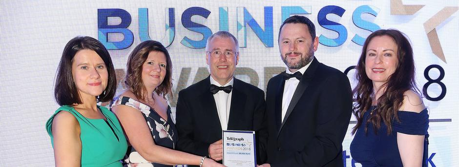 Gary Parkinson and Susan Hill from Novosco collect the Outstanding Business of the Year award from Richard Donnan of Ulster Bank, Margaret Canning (far left), Belfast Telegraph Business Editor and Gail Walker, Belfast Telegraph Editor
