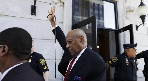 Bill Cosby gestures as he leaves the court (Matt Slocum/AP)