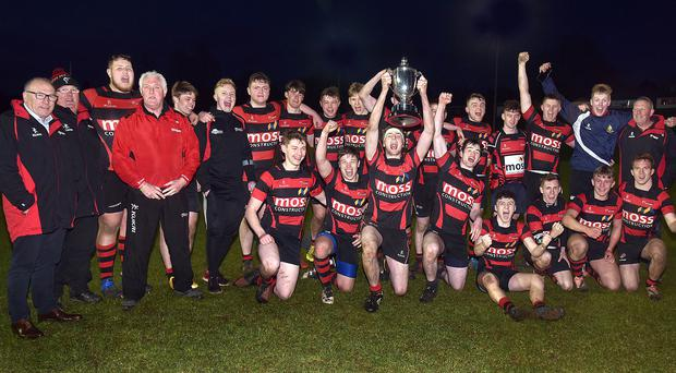 The Armagh u18 team celebrate with the trophy after their defeat of Ballynahinch in the final.