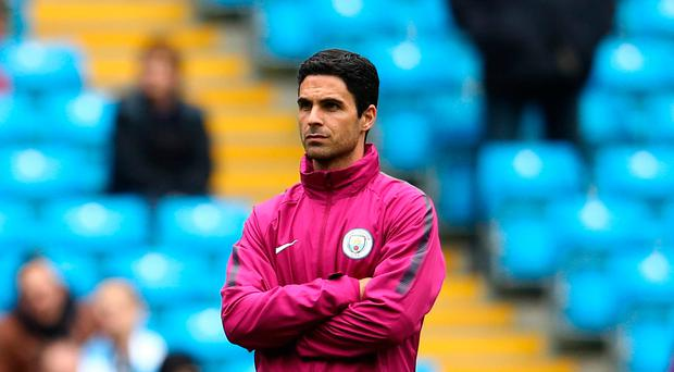 Huge step up: Manchester City assistant coach Mikel Arteta used to play for Arsenal