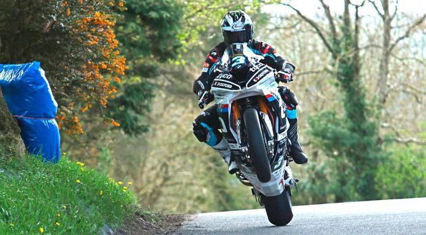 Flying high: Michael Dunlop made an impressive debut on his new Tyco BMW Superbike