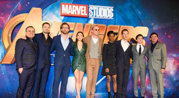 (Left to right) Joe Russo, Sebastian Stan, Tom Hiddleston, Elizabeth Olsen, Paul Bettany, Letitia Wright, Benedict Cumberbatch, Tom Holland and Anthony Russo attending the Avengers: Infinity War UK Fan Event (Matt Crossick/PA)