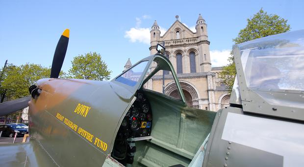 Press Eye - Belfast - Northern Ireland - 29TH April 2018 Service to mark the centenary of the formation of the Royal Air Service. at St Anne's Church of Ireland Cathedral in Belfast. A replica Spitfire pictured in front of the cathedral Picture by Jonathan Porter/PressEye