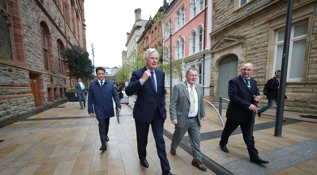 Michel Barnier is joined on a walk about in Derry city by Mayor Maoliosa McHugh (Niall Carson/PA)