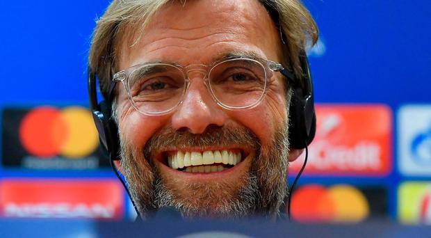 Confident: Jurgen Klopp faces the media in Rome yesterday