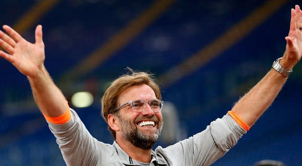 Liverpool manager Jurgen Klopp walks out to meet the Liverpool fans after reaching the Champions League final.