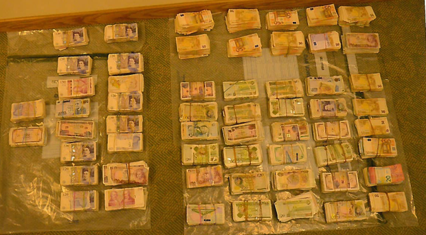 Cash seized by the PSNI in a drugs and money laundering investigation. Credit: PSNI