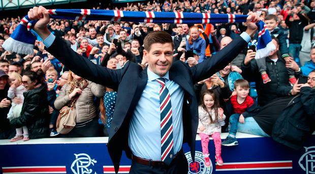 Fantastic reception: Steven Gerrard poses in front of Rangers fans at Ibrox