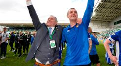 Winners: Coleraine boss Oran Kearney toasts his side's Irish Cup success with club chairman Colin McKendry