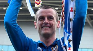 Cup king: Oran Kearney lifts the prize at Windsor Park