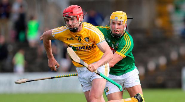 Front runner: Antrim's Simon McCrory breaks clear of Meath's James Kelly during Saturday's Joe McDonagh Cup round one game in Navan