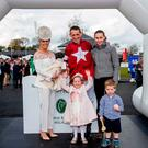 Family first: Davy Russell, with wife Edelle and children Jamie, Lilly, Finn and baby Liam after being crowned Champion National Hunt Jockey for the third time