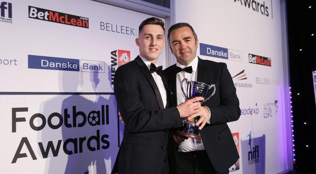 Gerry Flynn makes a presentation to Gavin Whyte, Young Player of the Year. Photo by Kelvin Boyes / Press Eye